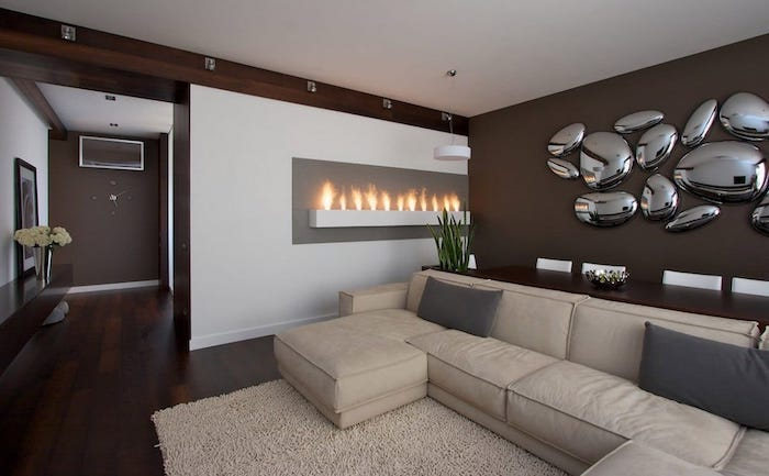 dining room wall decor, beige corner sofa, brown wall with metal stones 3d installation