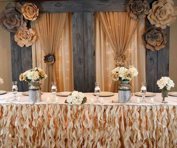 orange tulle with fairy lights backdrop, brown and white flower bouquets in metal vases, brown and beige paper roses, wedding ideas for summer