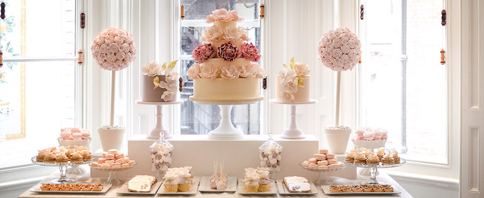 cakes on a cake stand, macaroons and cupcakes in plates, pink roses bouquet, fall wedding ideas