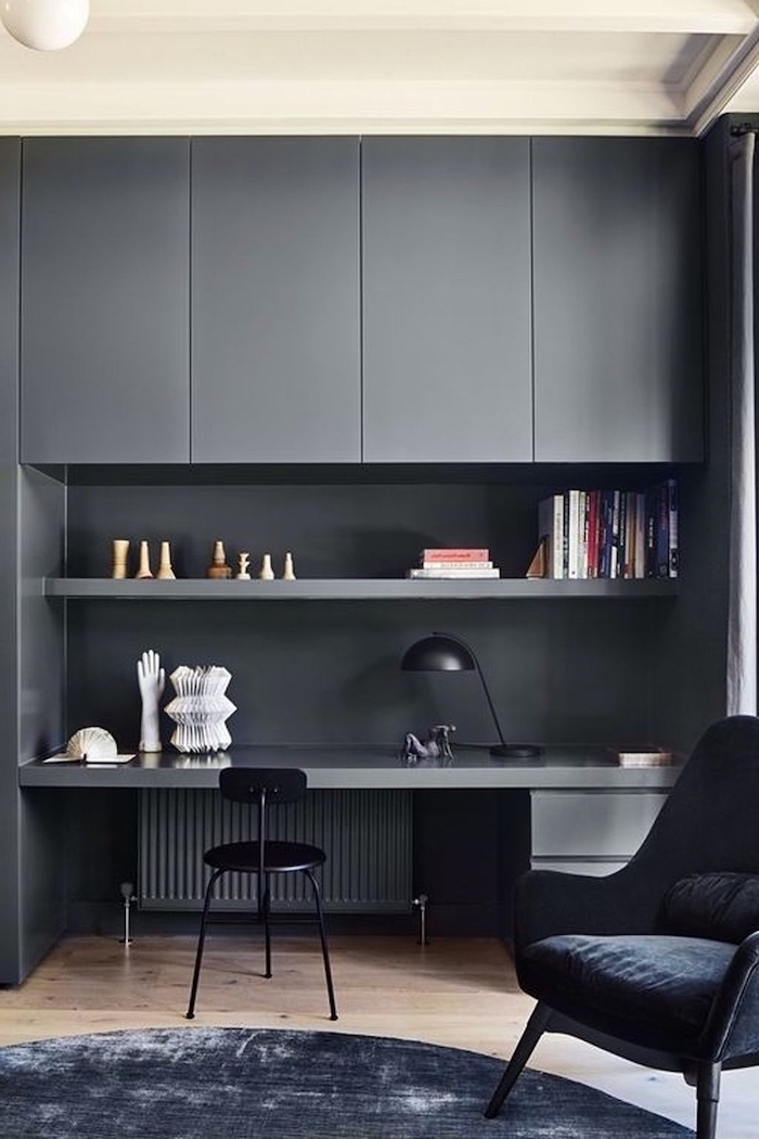 grey cupboards shelf and desk, home office design, black chair, black velvet rug and armchair