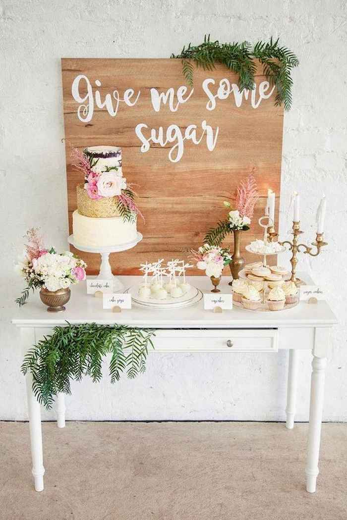 give me some sugar wooden sign, cake on a cake stand, pink and white flower bouquets, fall wedding ideas