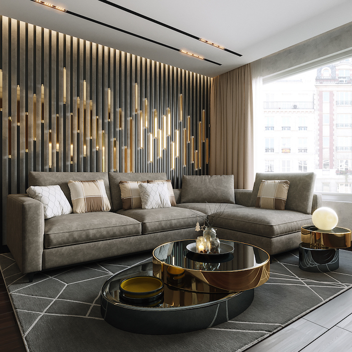black and gold wall installation, grey corner sofa, glass coffee table, accent wall colors
