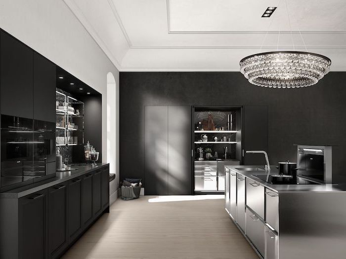 black cabinets and drawers, modern kitchen ideas, stainless steel drawers and counters, hanging chandelier