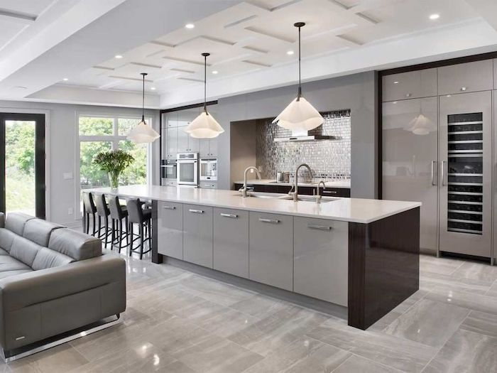 grey cabinets and kitchen island, tiled backsplash and floor, kitchen ideas, hanging lamps