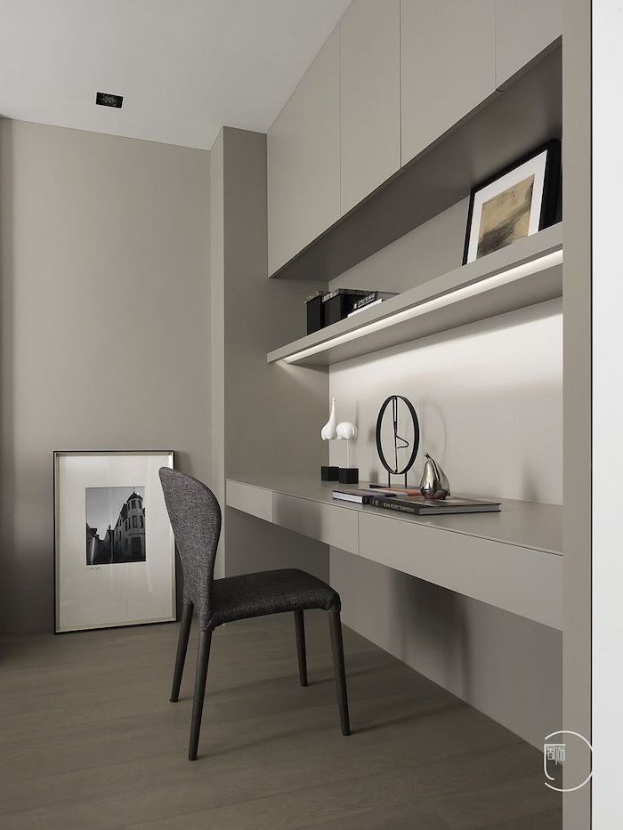 grey bookcase and cabinets, dark grey chair, cute office decor, grey walls and wooden floor
