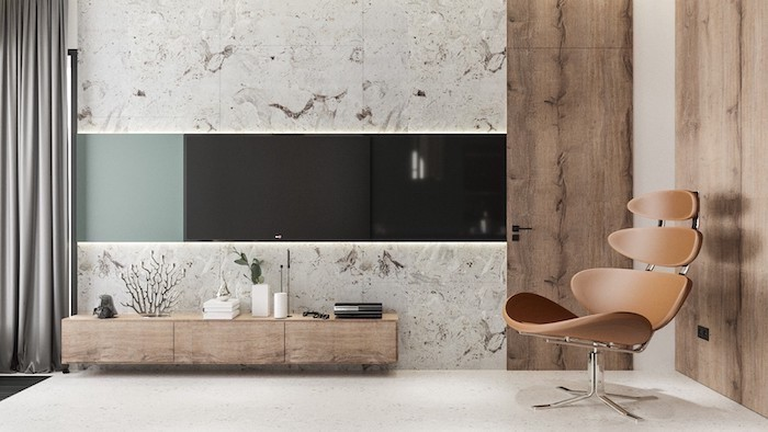 marble tiles on the wall, brown leather chair, wall painting ideas, wooden cabinet