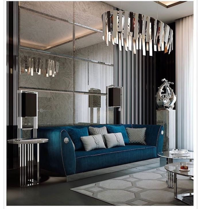 blue velvet sofa, mirror tiles wall, hanging chandelier, best color for living room walls