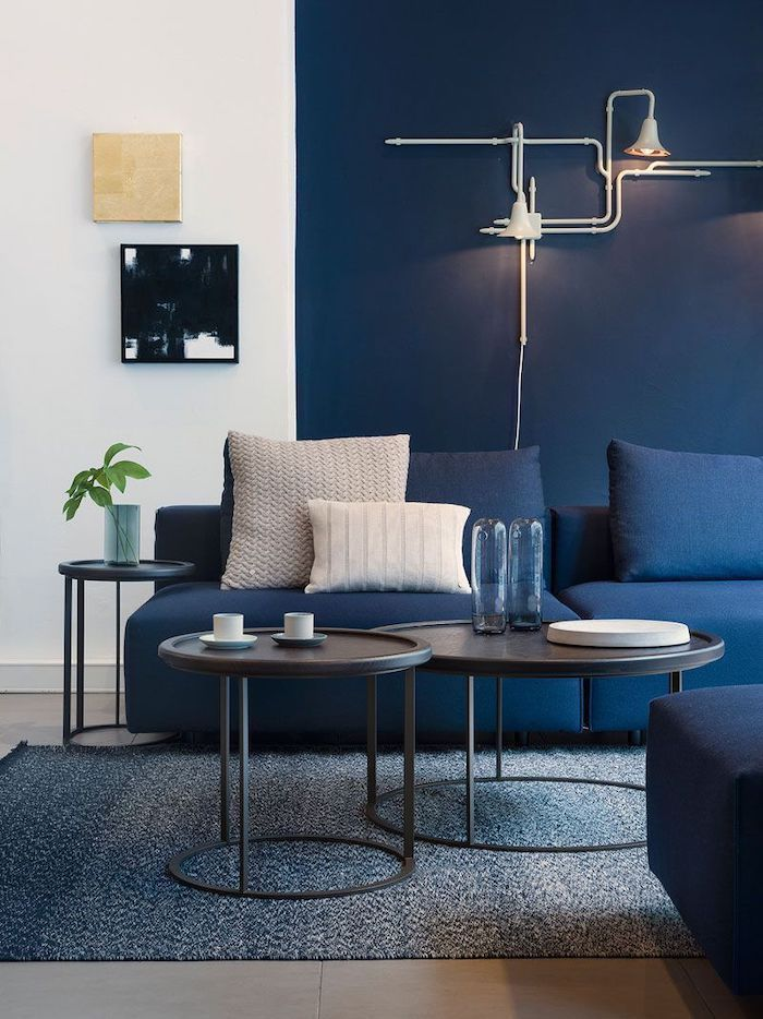 blue and white wall, lamps mounted on the wall, feature wall, round coffee tables