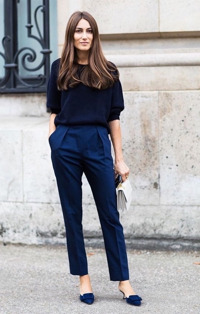 navy blue trousers, navy velvet loafers with heels, dark navy blue blouse, white clutch, business casual attire