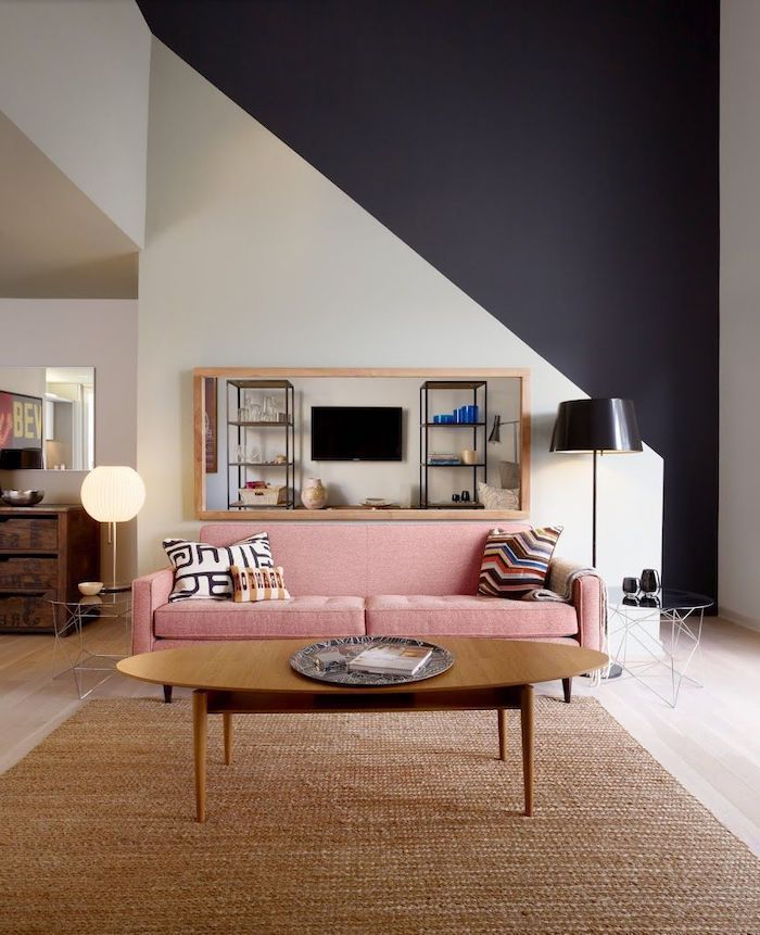 white and black geometrical wall, pink sofa, beige rug, wall designs