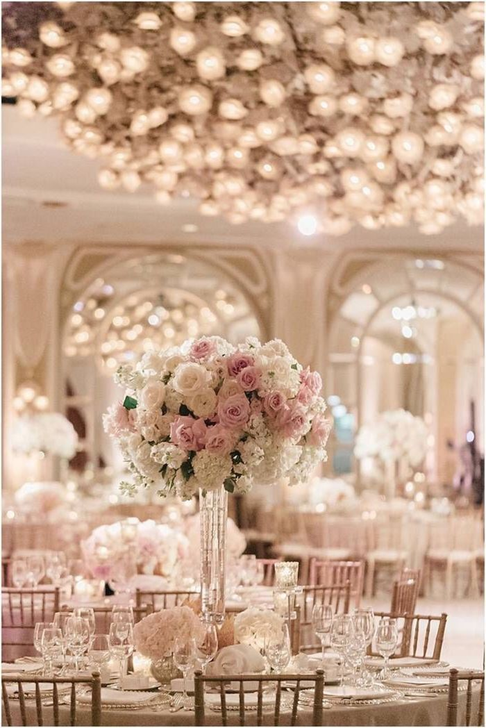 pink and white flower bouquet in a high vase, round tables with dinner sets, outdoor wedding ideas