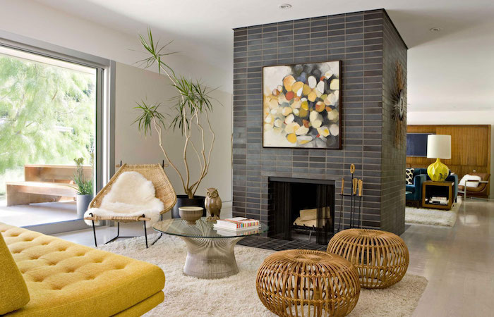 shades of grey tiles with an abstract painting, yellow sofa, accent wall ideas bedroom, wooden armchair and stools