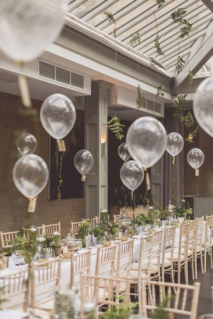 white balloons, green flower bouquets in vases on the table, wedding ideas for spring