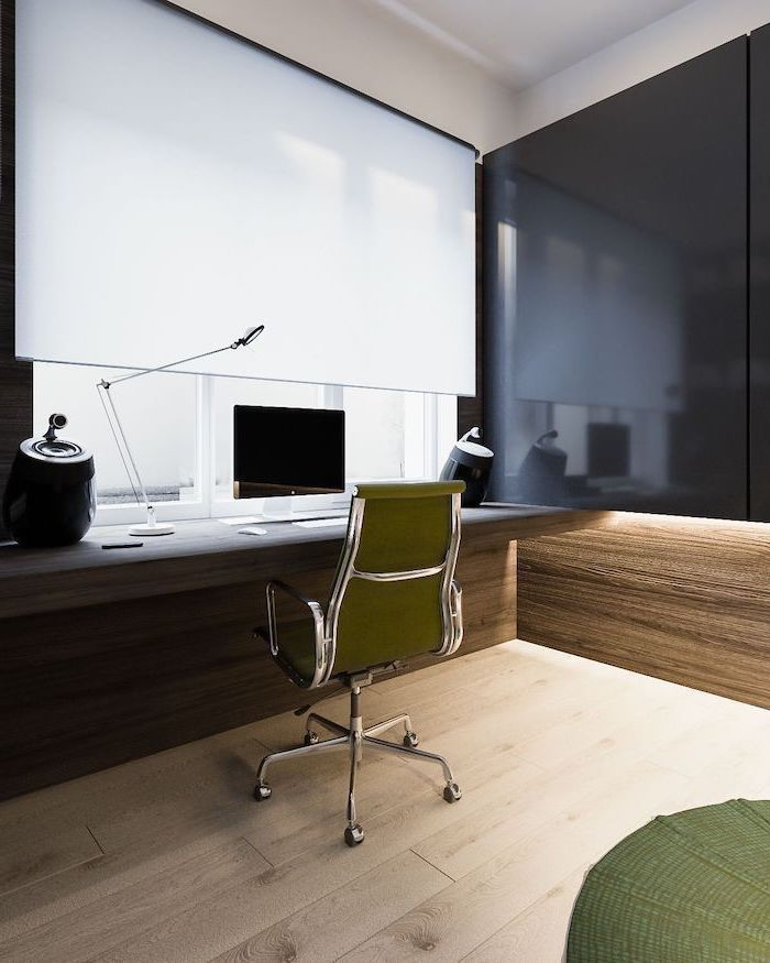 black and wood wall, wooden desk, green chair and rug, small home office desk, metal desk lamp