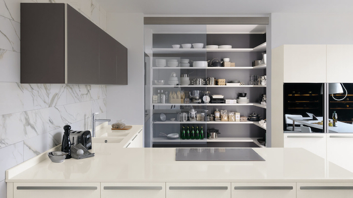 glass pantry, kitchen renovation, white cabinets and counter, marble tiled wall