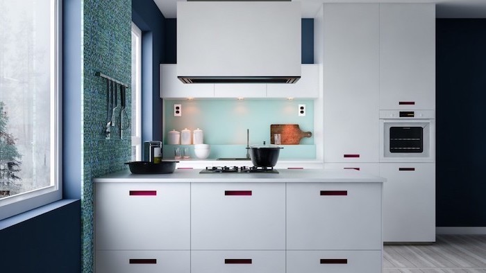 turquoise backsplash, navy blue walls, white cabinets and drawers, wooden floor, kitchen cabinets pictures