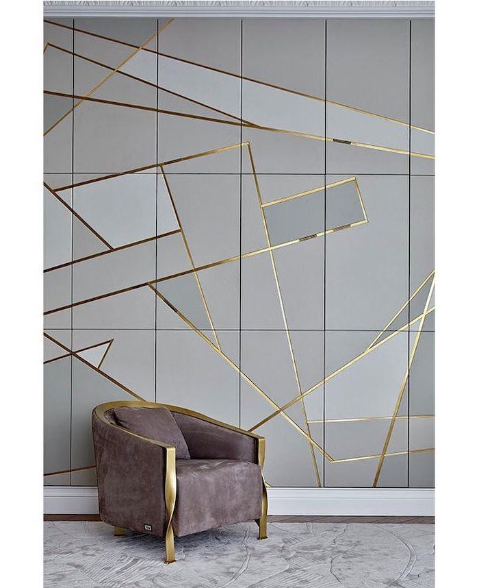 grey and gold geometrical tiles, grey velvet armchair, dining room pictures for walls