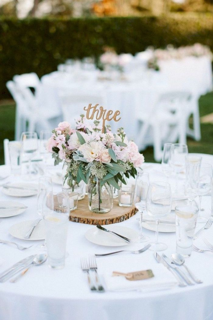 wooden centrepiece with a table number, pink and white flower bouquet in vases, diy wedding decorations