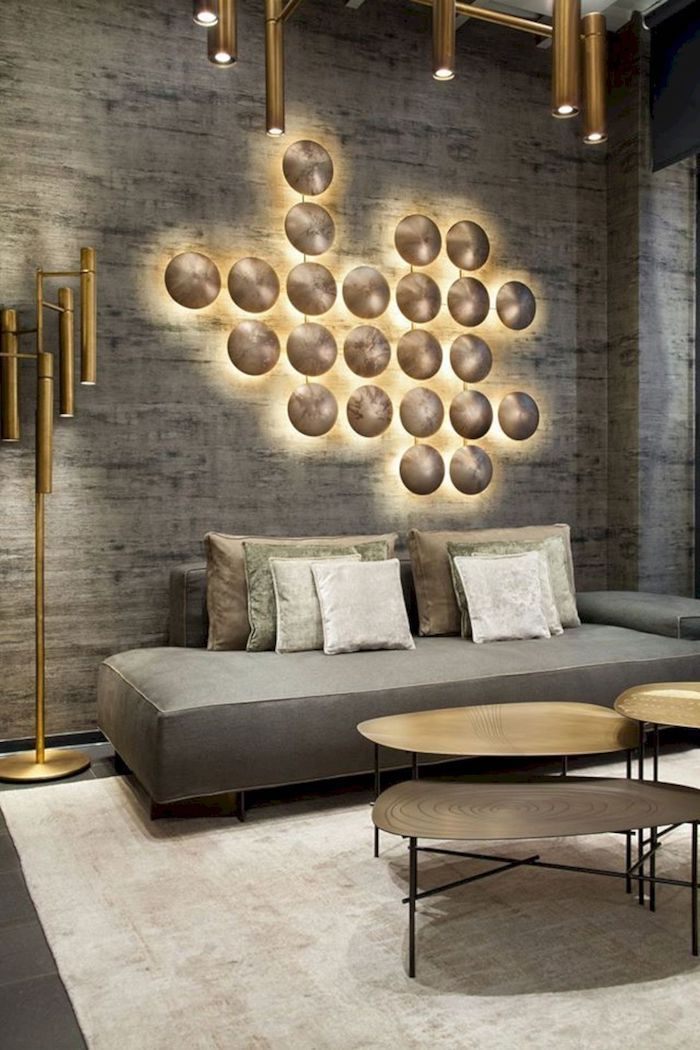 grey and golden lights 3d wall installation, wallpaper accent wall, grey sofa, metal coffee table