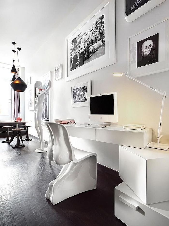 white desk and drawers, white statue and chair, home ideas, black wooden floor, white wall with paintings