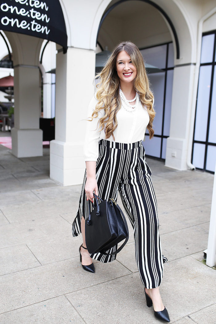 black and white stripe trousers, white shirt, black shoes and leather bag, white pearl necklace, women's professional clothing