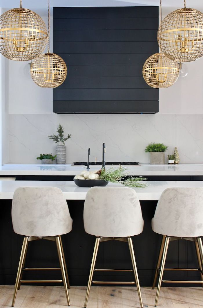 golden lamps, white velvet stools, kitchen remodel, black kitchen island, white counters