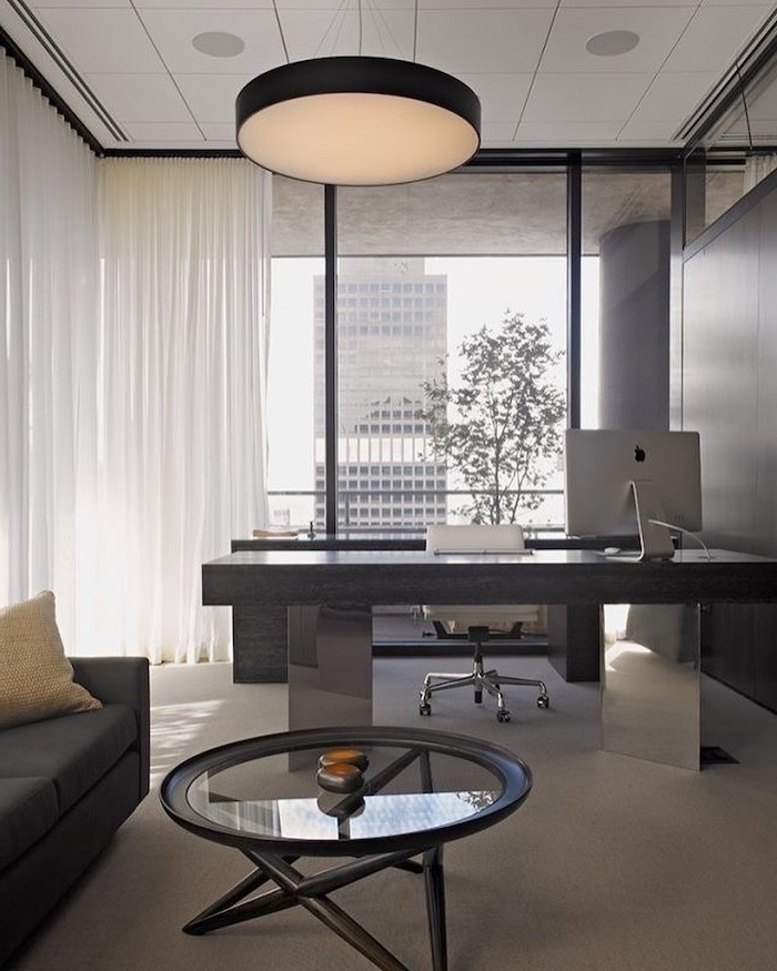 black walls, glass coffee table, wooden desk, work office decorating ideas, dark grey sofa, white leather chair