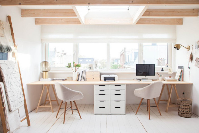 long wooden desk, white chairs, white drawers, lamp hanging from the wall, office design