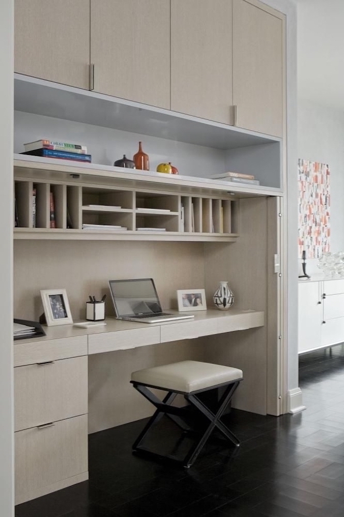 wooden bookcase with cabinets shelves and drawers, business office decorating ideas, beige leather stool
