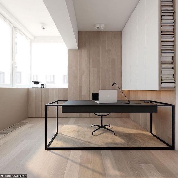 wooden wall and floor, beige velvet rug, black desk and chair, home office design, laptop and desk lamp on the desk
