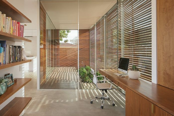 wooden bookshelves and desk, white leather chair, business office decorating ideas, wooden blinds