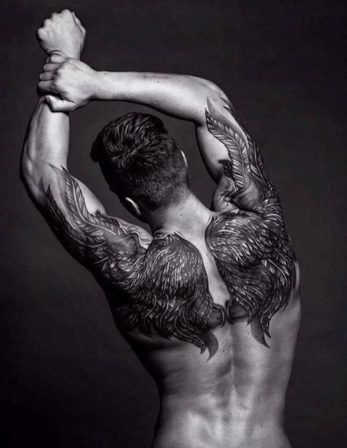 man stretching, angel wings, back tattoo, forearm tattoos, black background, brown hair