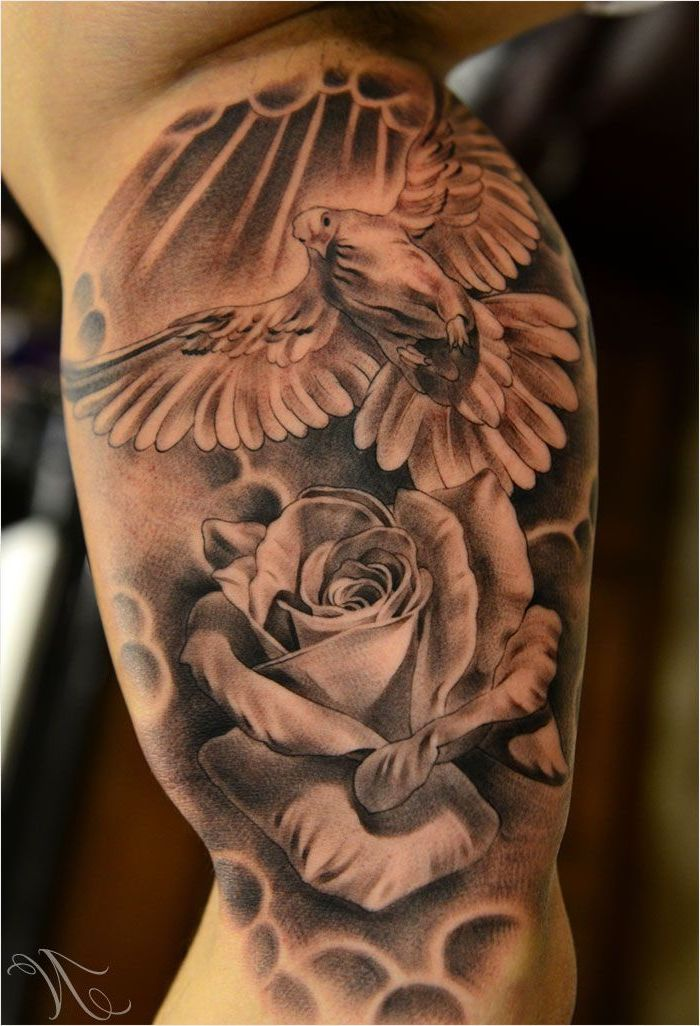 flying bird and rose, forearm tattoos for men, inner arm tattoo, blurred background