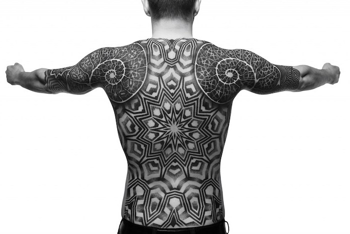 intricate black and white, whole back tattoo, man stretching his arms, white background, sleeve tattoos for men
