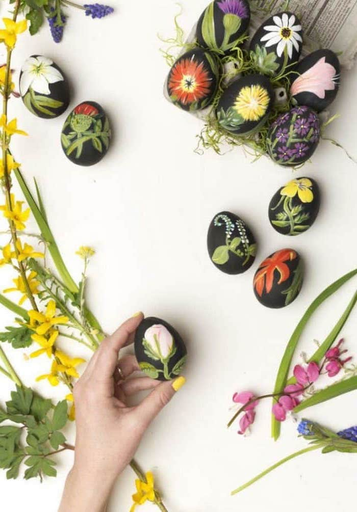 floral eggs, black egg dye, how to color eggs, flowers around, dyed eggs in an egg carton, white background