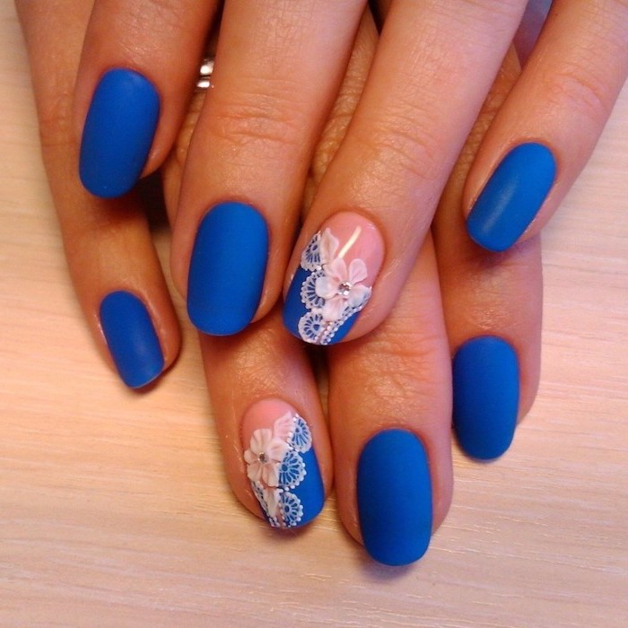 blue matte nail polish, easy nail designs, squoval nails, flowers drawn on two of the nails