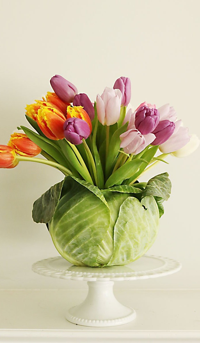large bouquet of tulips, inside a cabbage, easter decorating ideas, on a cake stand