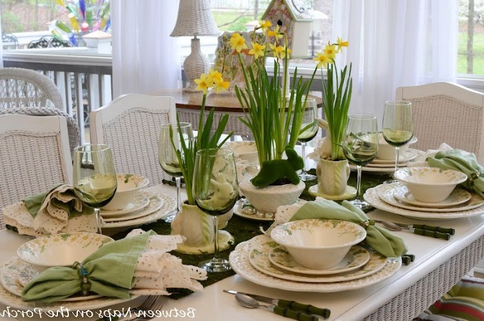 tall wine glasses, white and green plate settings, bouquets of flowers, easter home decor