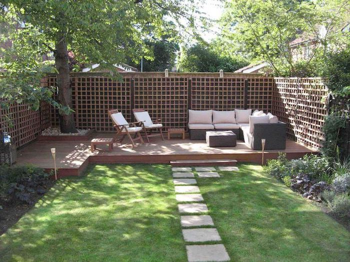 cement tiled pathway, on a patch of grass, leading to the garden furniture, garden decoration ideas