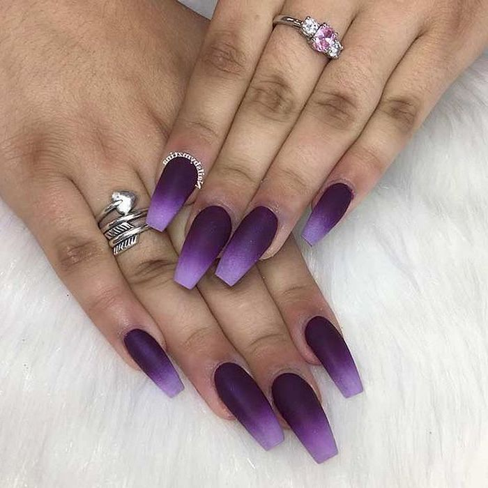 light and dark purple ombre nail polish, pink nail designs, long coffin nails, diamond ring on the middle finger