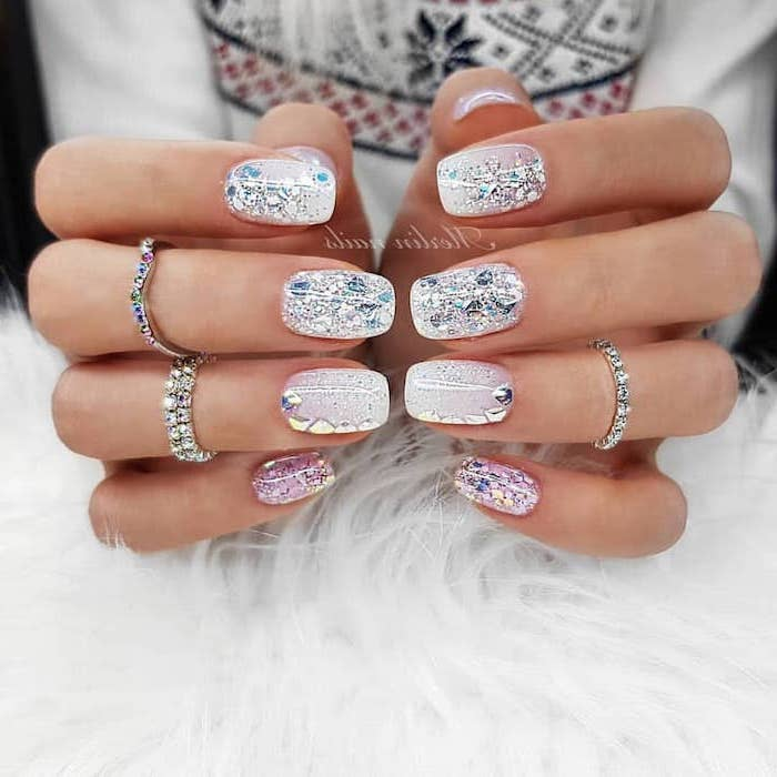 silver rings on the fingers, pink nail designs, different glitter nail polish, short squoval nails