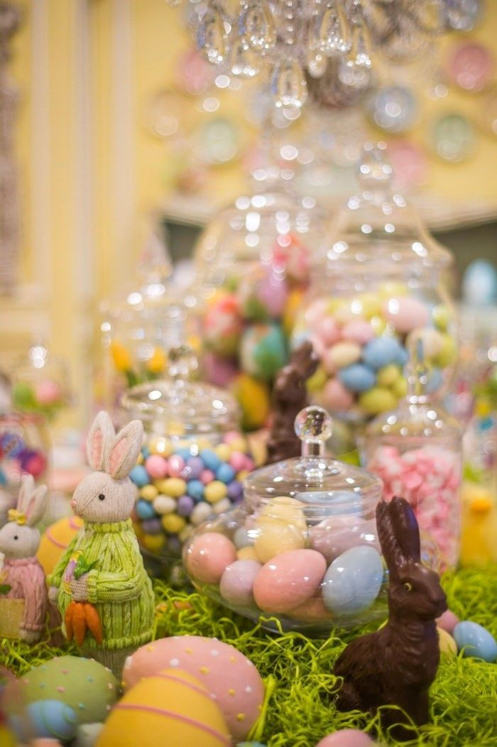 large candy jars, full of dyed and chocolate eggs, easter decorating ideas table setting, bunny figurines