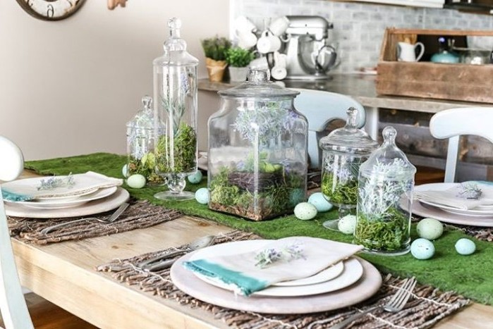 pinterest easter decorations, large glass candy jars, dyed eggs, scattered on a green table runner