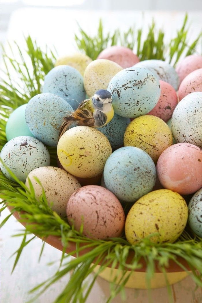 colourful eggs, in a wooden basket, with grass inside, plastic bird on top, how to make easter eggs