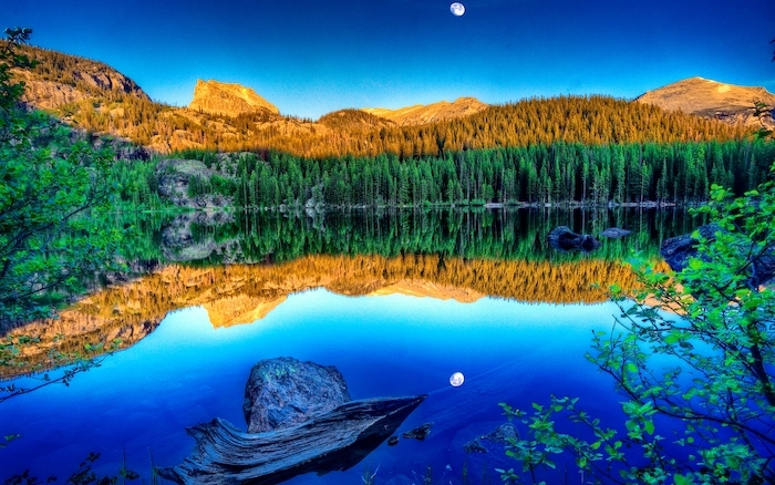 mountain landscape, lots of trees, surrounding a large lake, spring wallpaper for desktop, moon in the sky