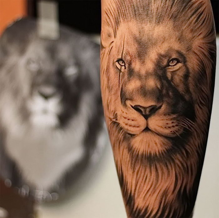 wrist tattoos for men, lion head, black and white tattoo, blurred background