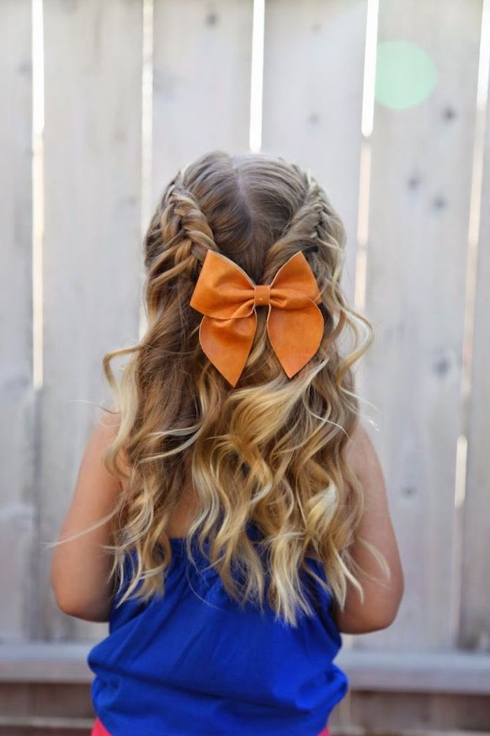 large orange bow, long blonde wavy hair with two braids, cool hairstyles for girls, blue top