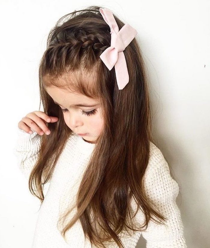 large pink bow, long brown hair, side braid, white sweater and background, easy hairstyles for girls