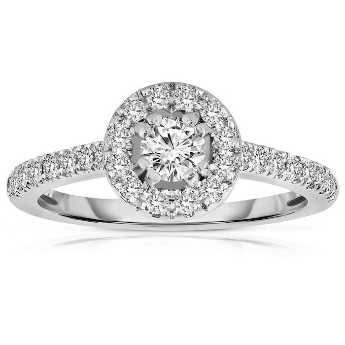 teardrop engagement ring, large round diamond, surrounded by smaller diamonds, diamond studded band