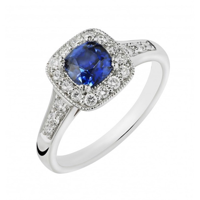 square cut sapphire surrounded by diamonds, white gold band, beautiful engagement rings